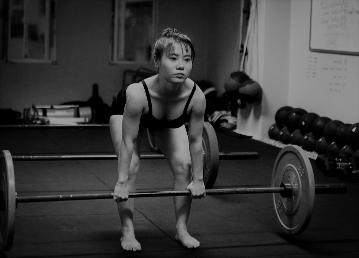Woman Barbell Deadlifting